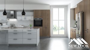 Digital drawing of kitchen with maple wood cabinets, white countertop, and black lights over the countertop
