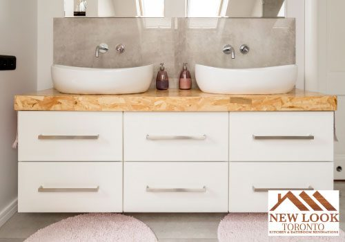 bathroom with two sinks and cabinets